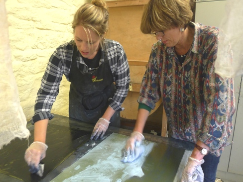 Emma Stibbon RA and Amy-Jane Blackhall inking and wiping plates at INK on PAPER PRESS