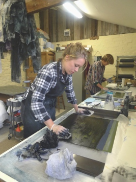Emma Stibbon RA and Amy-Jane Blackhall wiping plates at INK on PAPER PRESS